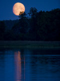Moon Light Reflecting in Calm Lake Water Photographic Print by Mattias Klum