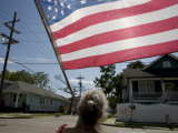 Woman with the Flag She Flew on Her Flooded Out Home in New Orleans Photographic Print by Tyrone Turner