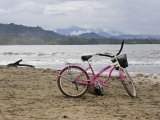 Pink Bike Sits on the Beach in Cahuita National Park Photographic Print by Hannele Lahti