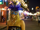 Woman Wears a Mardi Gras Mask on Bourbon Street Photographic Print by Taylor S. Kennedy