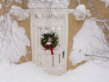 Snow Covered Christmas Wreath with a Bow Adorns a Door in Santa Fe Photographic Print by Ralph Lee Hopkins