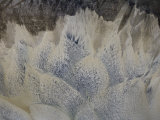 Tidal Currents and River Water Creating a Bird Feather Pattern Photographic Print by Michael Polzia