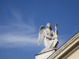 Angel Sculpture on a Roof Top Photographic Print by Scott Warren