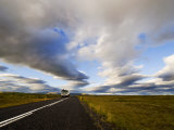 Truck on a Road under a Sky Filled with Heavy Clouds Photographic Print by Mattias Klum