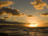 Solitary Surfer Enters the Water as the Sun Sets in Hawaii Photographic Print by Charles Kogod