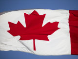 Flag of Canada Flies High over the Parliament Buildings Photographic Print by Pete Ryan