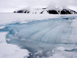 Meltwater Pool Drains into a Forming Crevasse on Jakeman Glacier Photographic Print by John Dunn