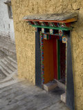 Colorful Doorway at the Ganden Sumseling Gompa or Monastery Photographic Print by Scott Warren