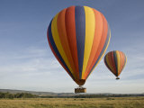 Hot Air Balloons over the Mara Photographic Print by Michael Polzia
