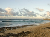 Surfer Walks Along the Beach at Rocky Point on Oahu Island in Hawaii Photographic Print by Charles Kogod