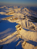 Aerial of Snow Covered Cliffs Photographic Print by Nick Norman