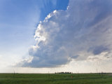 Crepuscular Rays Shining Through a Rising Cumulous Cloud Photographic Print by Mike Theiss