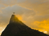 Christ the Redeemer Statue Atop Corcovado in Orange Glow at Sunset Photographic Print by Mike Theiss