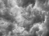 Looking Up into a Thunderstorm at the Dark and Ominous Clouds Photographic Print by Mike Theiss
