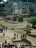 Tourists Walk Through Rome's Ancient Forum with Palatine Hill Behind Photographic Print by O. Louis Mazzatenta