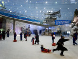 Indoor Winter Wonderland with Snow, Sleds, and Snowboard Lessons Photographic Print by Mattias Klum
