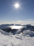 Sun Shines over Mountain Ridges of Coburg Island and Baffin Bay Photographic Print by John Dunn