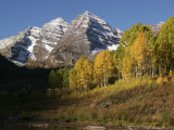 Majestic Maroon Bells Loom Above Maroon Lake Photographic Print by Charles Kogod