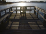 Sunset Sparkles and Casts Shadows on a Peaceful Pier Photographic Print by Stephen St. John