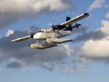 Sea Plane Flies Amid the Clouds Photographic Print by Pete Ryan