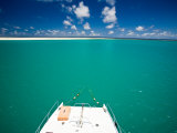 Boat Anchored in the Calm Blue Waters of the Seychelles Photographic Print by Beverly Joubert