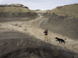 Teenage Hiker and His Black Lab in the Bisti Badlands Wilderness Photographic Print by Scott Warren
