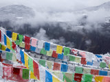 Buddhist Prayer Flags in Fresh Snow East of Deqin Photographic Print by Scott Warren