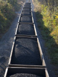Train Cars Filled with Coal Travel the Rails Photographic Print by Stephen St. John