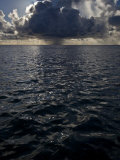 Dark Storm Cloud Drops Rain over the Ocean Photographic Print by Michael Melford