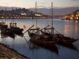 Wine Barrels on Boats in Oporto at Dusk Photographic Print by Michael Melford