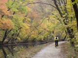 Biker on the C&O Canal Towpath Near Potomac Photographic Print by Skip Brown