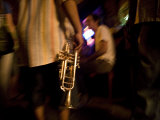 Musician Holding Trumpet in a Busy Bar Photographic Print by Tyrone Turner