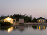 Cozy Beach Cottages at Twilight Casting Reflections in Calm Water Photographic Print by Scott Warren