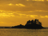Filter Enhanced Sunset View of a Silhouetted Island Photographic Print by Nick Norman