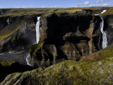 Scenic View of a Canyon, Cliffs, and a Waterfall Photographic Print by Mattias Klum