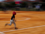 Boy Runs During a Baseball Game at Night Photographic Print by Raul Touzon