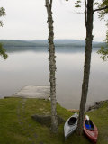 Two Kayaks Sit on Shore at Embden Pond in Maine Photographic Print by Hannele Lahti