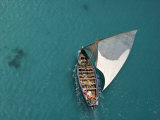 Aerial Shot of a Dhow Sailing in Turquoise Water Photographic Print by Michael Polzia