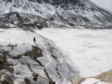 Lake Ice Draped over Sloping Shore after Water Drained During Winter Photographic Print by John Dunn