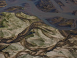 Swirling Patterns of River Runoff Mingling with Coastal Sands Photographic Print by Michael Polzia