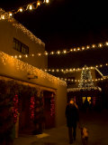 Woman Walks a Dog and Admires the Holiday Lights in Santa Fe Photographic Print by Ralph Lee Hopkins