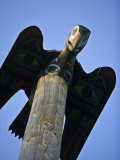 Carved Wooden Bird at the Top of a Totem Pole in Ketchikan, Alaska Photographic Print by Michael Melford