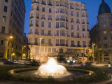 Buildings and a Fountain at Dusk Along the Gran Via in Madrid Photographic Print by Scott Warren