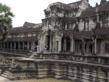 Tourists Exploring the Temple Complex at Angkor Wat Photographic Print by Rebecca Hale