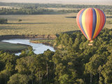 Hot Air Balloon over the Mara Photographic Print by Michael Polzia