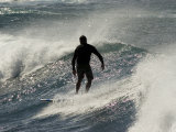 Surfer in the Pacific Ocean Off the North Shore of Oahu in Hawaii Photographic Print by Charles Kogod