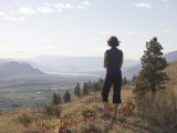 Woman Looks Down the Okanagan Valley Photographic Print by Taylor S. Kennedy