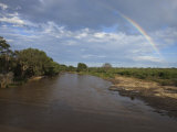 Rainbow Arcs over a River in Samburu National Park Photographic Print by Michael Nichols
