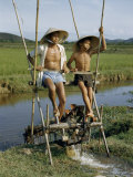 Father and Son Irrigate Rice Fields by Pedaling an Irrigation Machine Photographic Print by Joseph Baylor Roberts