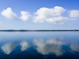 Fluffy Clouds Float over a Perfectly Still Lake on a Hot Summers Day Photographic Print by Jason Edwards